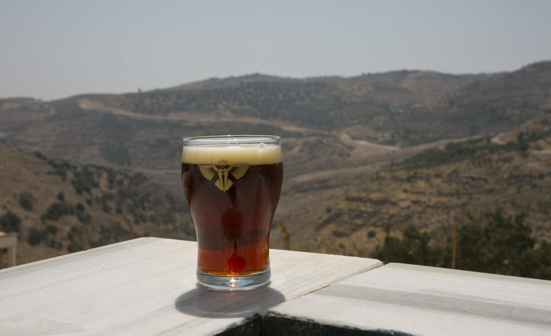 A Carakale beer with Jordanian hills in the background.