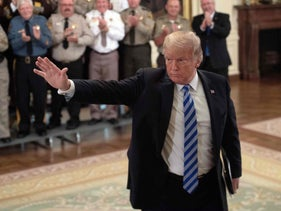 US President Donald Trump waves during a meeting with sheriffs from across the US at the White House in Washington, DC, on September 5, 2018