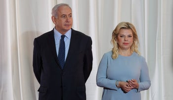Israeli Prime Minister Benjamin Netanyahu and his wife Sara wait for the arrival of Ethiopian Prime Minister and his wife ahead of a welcoming ceremony at the PM's office in Jerusalem.