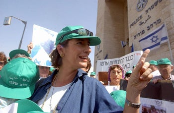 Nadia Matar, co-leader of Women in Green, on her way to a police interrogation in 2004.