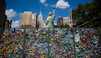 "The ""Drowning Liberty"" installation is displayed at Flatiron Plaza in New York, U.S., on Sept. 4, 2018."