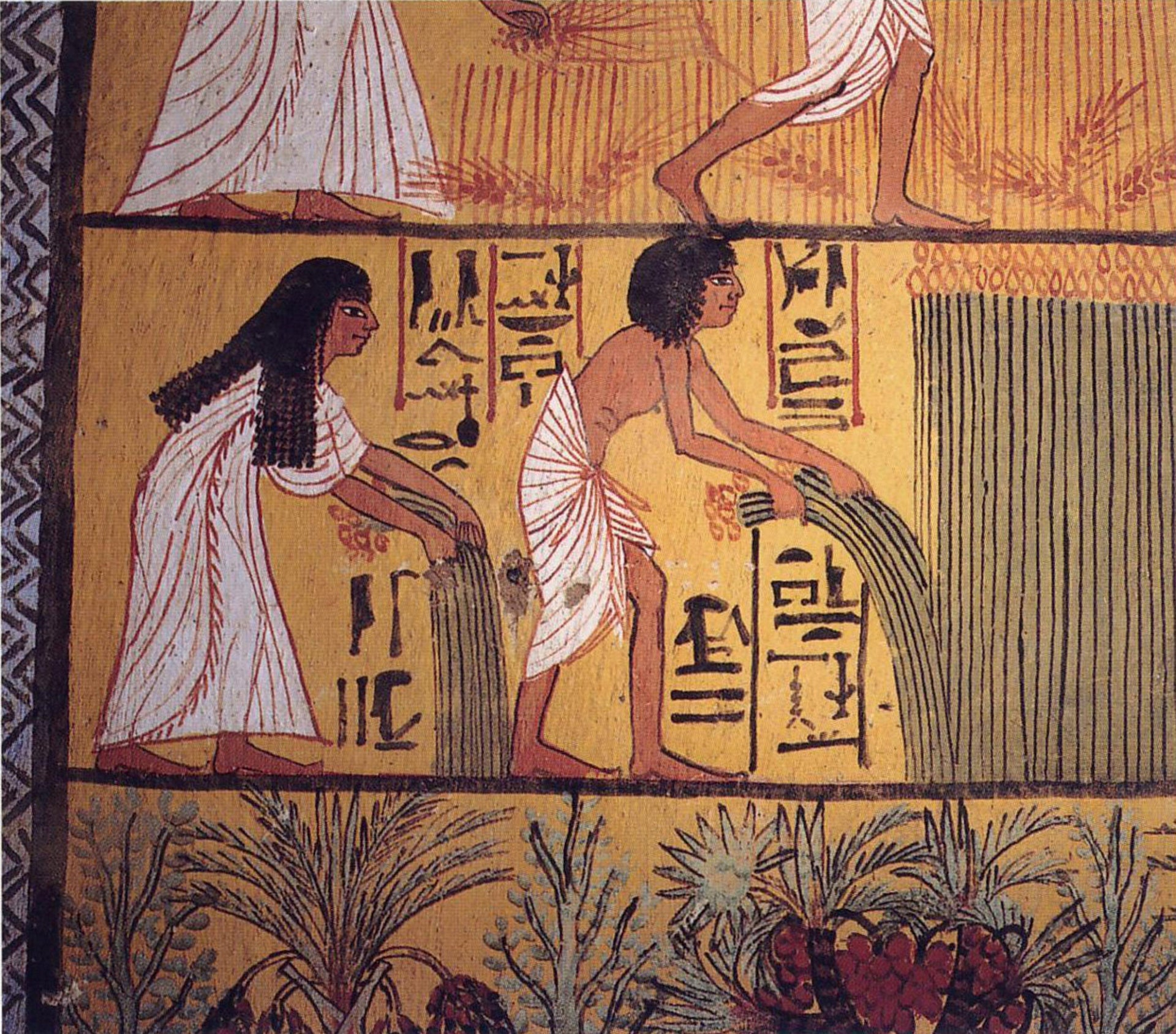 Hieroglyph shows a peasant couple harvesting papyrus, with pomegranate trees below.