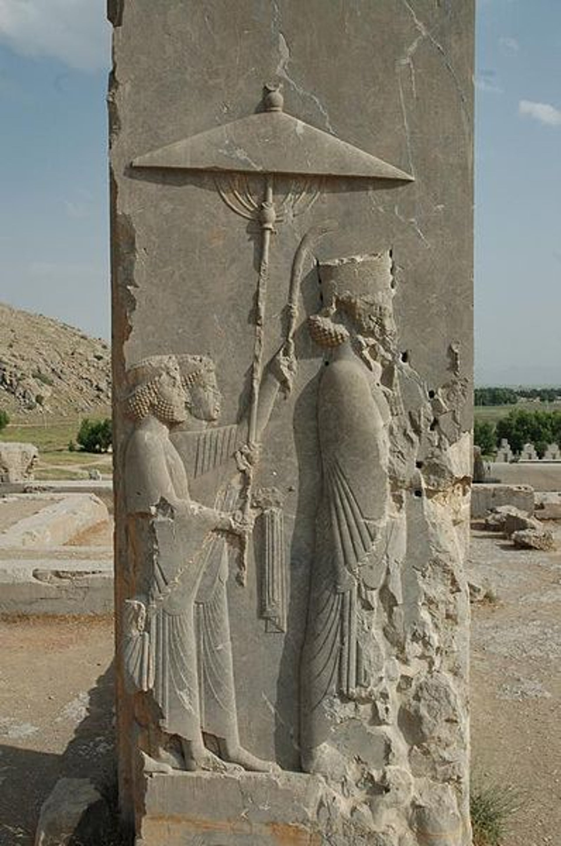 Relief of the Persian king Xerxes (485-465 BC) in the doorway of his palace at Persepolis, modern-day Iran. The bearers of the parasol and the towel-and flywhisk symbolize the royalty and power of the monarch.