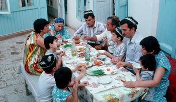 Members of a Jewish community in Uzbekistan eating a meal together, February 4, 2018.