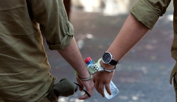 Archive: Israeli soldiers cuffed to one another at a military court.