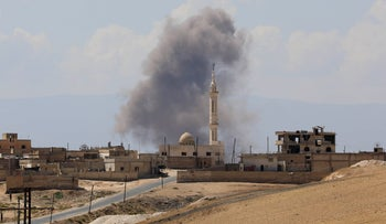 Smoke billows following Syrian government forces' bombardment around the town of Khan Sheikhun on the southern edges of the rebel-held Idlib province on September 8, 2018.