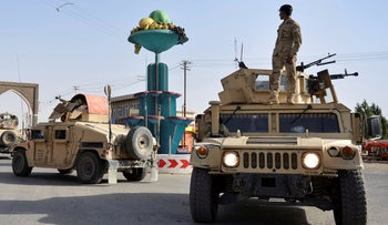 FILE Photo: Afghan Security personnel petrol in the city of Ghazni province west of Kabul, Afghanistan, Aug. 12, 2018.