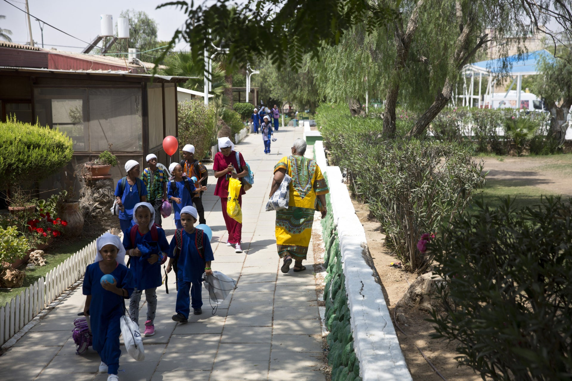Children from the Hebrew-Israelite community on their way back from school, in Dimona, September 2018