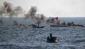 Palestinian protesters in boats take part in a demonstration near the maritime border with Israel, in the northern Gaza Strip, calling for the lift of the Israeli blockade on the coastal Palestinian enclave, on September 10, 2018.