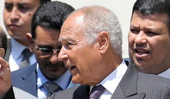 Arab League Secretary-General Ahmed Aboul Gheit speaking with Yemeni President Abd-Rabou Mansour after their meeting in Cairo, August 14, 2018.