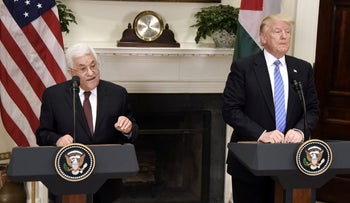 U.S. President Donald Trump listens while Palestinian President Mahmoud Abbas speaks during a joint press conference in the Roosevelt Room of the White House, Washington, May 3, 2017.