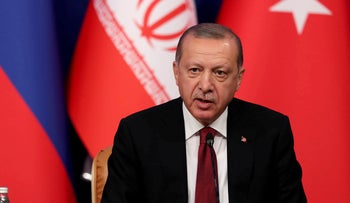 Turkish President Recep Tayyip Erdogan speaking during a news conference with Iranian President Hassan Rohani and Russia's Vladimir Putin, September 7, 2018.