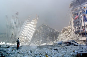 A man standing in the rubble after the collapse of the first World Trade Center Tower in New York, September 11, 2001.