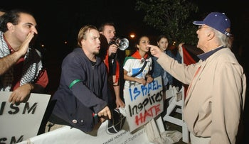 "File photo: A supporter of Israel argues with pro-Palestinian demonstrators at an ""Israel Inspires"" rally on the campus of Rutgers University in Piscataway, N.J., Oct. 9, 2003."