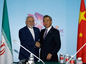 Iran's Foreign Minister Mohammad Javad Zarif and China's Foreign Minister Wang Yi shake hands at a bilateral meeting on the sidelines of the ASEAN Foreign Ministers' Meeting in Singapore, August 3, 2018.