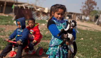 A girl from the Jahalin Bedouin tribe holds a goat, in the West Bank village of Khan al-Ahmar that is slated for demolition. 23 February 2017
