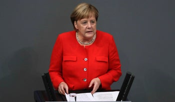 German Chancellor Angela Merkel delivers her speech during a plenary session of the German parliament Bundestag about the budget 2019, in Berlin, Sept. 12, 2018.