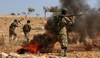 FILE PHOTO: Syrian rebel fighters from the recently-formed 'National Liberation Front' take part in combat training in the northern countryside of the Idlib province, September 11, 2018.