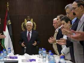 FILE Photo: Palestinian President Mahmoud Abbas, joins a reading of the Koran prior to a meeting of the Palestinian Liberation Organization (PLO) executive committee in Ramallah, August 22, 2015.