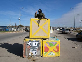 An Israeli soldier stands guard at the Gush Etzion junction in the West Bank in January, 2016.