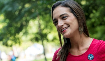 Democratic New York State Senate candidate Julia Salazar smiles as she speaks to a supporter before a rally in McCarren Park in the Brooklyn borough of New York.