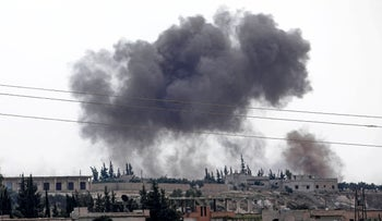 Smoke billows following Syrian government forces' bombardment around the town of Al Habit on the southern edges of the rebel-held Idlib province on September 9, 2018