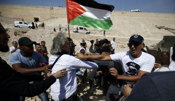 Protesters demonstrate against the blocking of the road leading to the Bedouin village of Khan al-Ahmar in the West Bank, September 14, 2018.