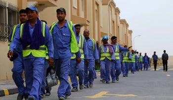 Qatari workers amid preparations for the 2022 World Cup.