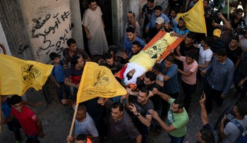 Palestinians carrying the body of 12-year-old Shady Abedl-al during his funeral in Gaza, Saturday, September 15, 2018.