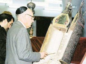 Tawfiq Safeer prepares for prayer in the synagogue of Baghdad, Saturday, March 21, 1998. Only about 76 Jews remain in Iraq, which once held the most prosperous and influential Jewish populations in the Middle East. But is now on the verge of extinction.