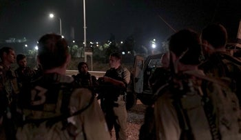Israeli army forces convene before entering the West Bank village of Yatta, September 17, 2018