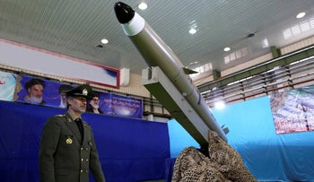 Iran's defense minister walks past a Fateh-e Mobin missile during inauguration of its production line at an undisclosed location, Iran, August 13, 2018.