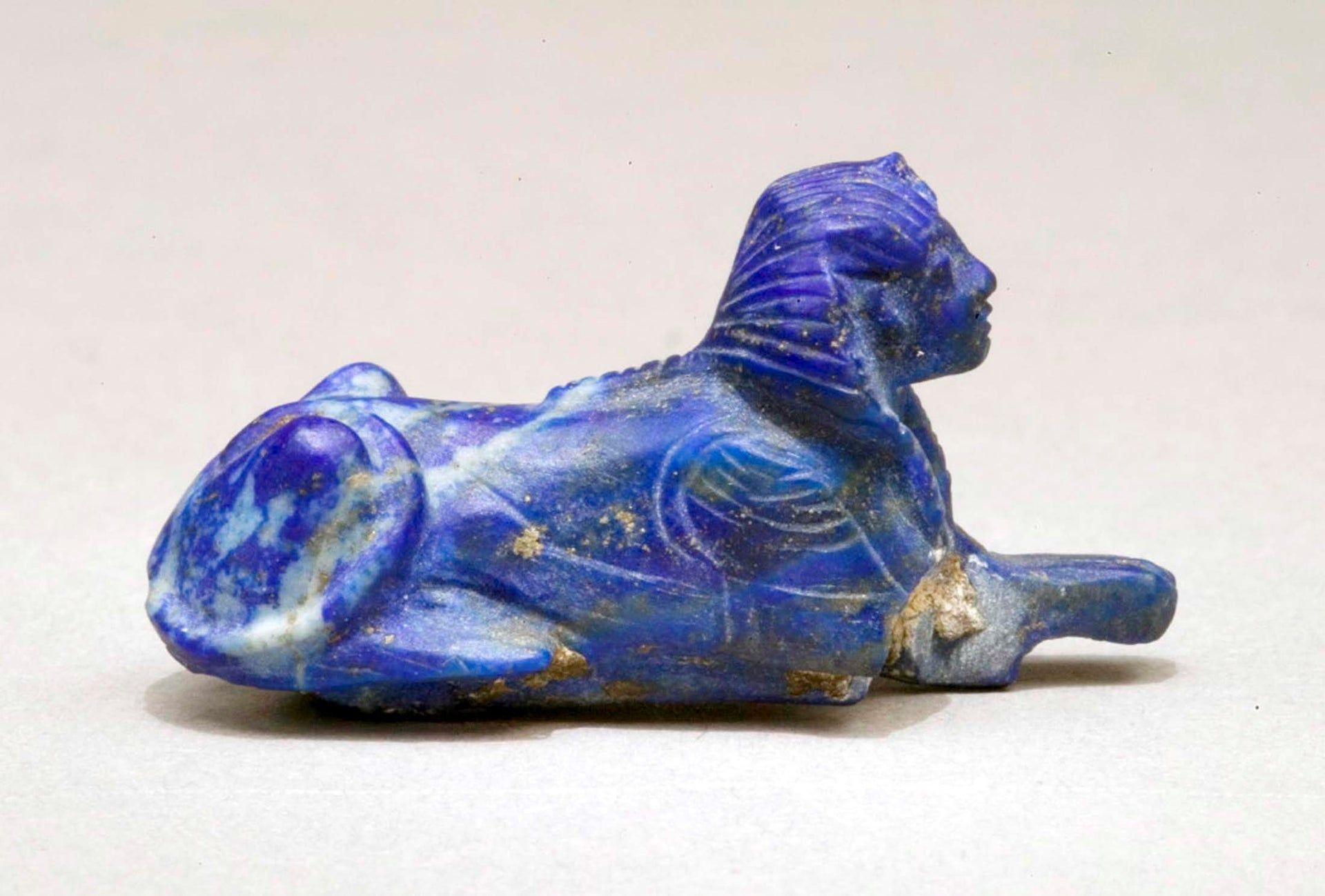 Bracelet inlay in the form of a sphinx made of lapis lazuli attributed to Tutankhamun's tomb, which was discovered by Howard Carter in 1922 in the Valley of the Kings is seen in this handout picture released on November 9, 2010 by the Egyptian Supreme Council of Antiquities and Metropolitan Museum of Art