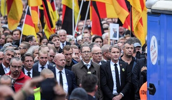 Bjoern Hoecker, leader of the Alternative for Germany, AfD, in German state of Thuringia, participates in a commemoration march in Chemnitz, eastern Germany, Saturday, Sept. 1, 2018
