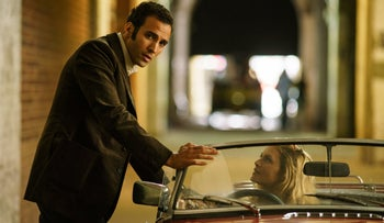 "Marwan Kenzari and Hannah Ware in ""The Angel."""