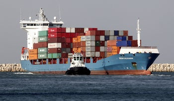 Container ship Irem Kalkavan is guided by a tug boat as she arrives at the Port of Haifa in Haifa, Israel.