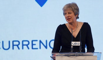 Britain's Prime Minister Theresa May speaks at the United Jewish Israel Appeal (UJIA) dinner in central London on September 17, 2018.