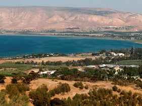 People gather along the shore of Lake Kinneret in northern Israel, August 30, 2018.