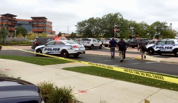 Emergency personnel arrive at the scene where a shooting was reported at a software company in Middleton, Wisconsin, a suburb of Madison, Wednesday, Sept. 19, 2018.