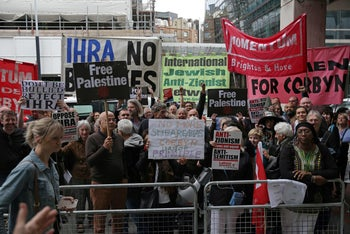 Demonstrators protest the adoption of the IHRA definition of anti-Semitism, outside Britain's opposition Labour party HQ in central London. September 4, 2018