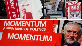A t-shirt depicting Jeremy Corbyn, leader of the U.K. opposition Labour Party, Mugs and books including 'The Corbyn colouring book' stand on display for sale in the 'Literary Tent', Leaflets for Momentum, the group set up to support UK Labour party head Jeremy Corbyn.
