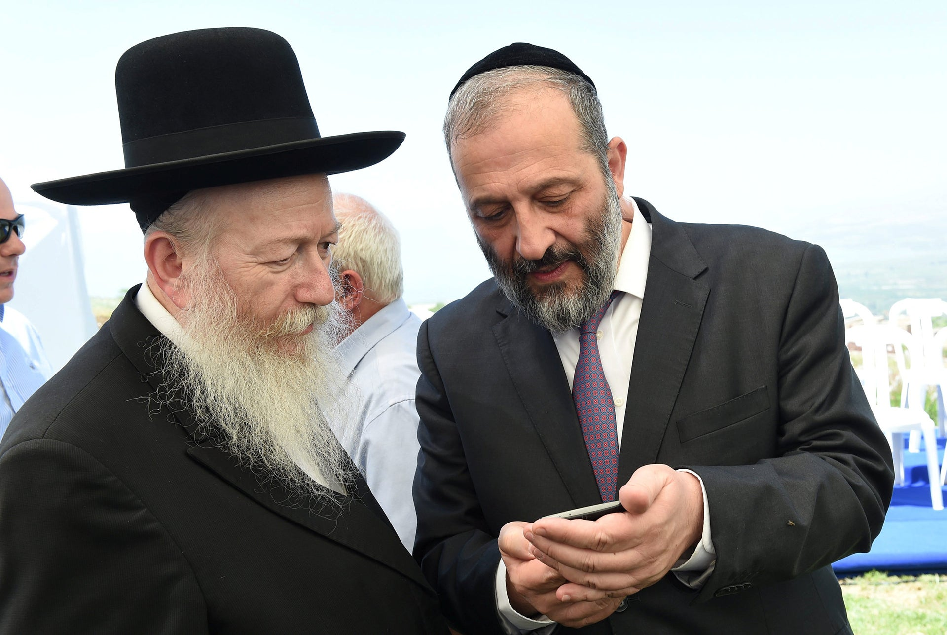 Shas Chairman Arye Dery and Deputy Health Minister Yaakov Litzman. Netanyahu says he's proposing a lower threshold for Dery, but Dery's driven by only one consideration.