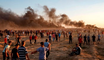Palestinian protesters gather during demonstration along the Israeli border fence east of Gaza City on September 21, 2018.