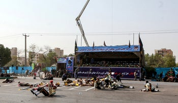 Injured Iranian soldiers lying on the ground at the scene of an attack on a military parade on in the southwestern city of Ahvaz, Iran, September 22, 2018
