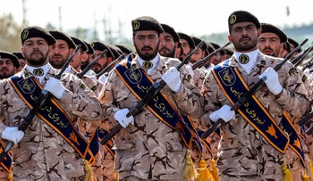 Members of Iran's Revolutionary Guards Corps march during the annual military parade marking the anniversary of the outbreak of the Iran-Iraq War, in Tehran on September 22, 2018.