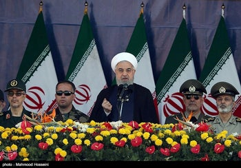 Iranian President Hassan Rohani delivers a speech during the annual military parade marking  in Tehran, Iran, September 22, 2018.