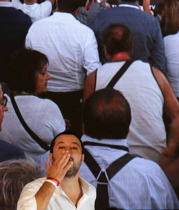 Italian Interior Minister Matteo Salvini blows a kiss to a supporter as he arrives at the Brothers of Italy political meeting in Rome, September 22, 2018.