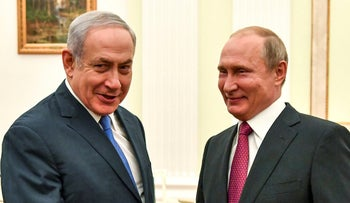 Russian President Vladimir Putin shakes hands with Prime Minister Benjamin Netanyahu during their meeting at the Kremlin, Moscow, Russia, July 11, 2018.