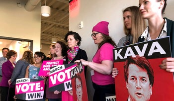 People hold signs of U.S. Supreme Court nominee Brett Kavanaugh at a rally and news conference Thursday, Sept. 20, 2018