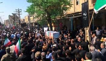 Mourners carry a casket during a mass funeral for those who died in a terror attack on a military parade in Iran in Ahvaz, Iran, Monday, Sept. 24, 2018